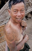 Elderly man with tattoos at Kyauktaing village on Lake Inle, Shan State, Myanmar.