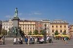 Krakow's Main Market Square (Rynek Glowny) with statue of poet Adam Mickiewicz.