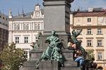 Krakow's Main Market Square (Rynek Glowny) with statues.