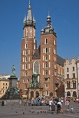 Krakow's Church of St. Mary and statue of poet Adam Mickiewicz in Main Market Square.