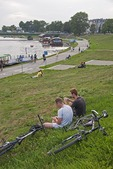 Krakow residents relaxing on bank of Vistula River.