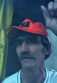 Folksinger Jay Stielstra at screen door of his home near Ann Arbor, Michigan, USA, 1984.
