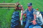 Farmer Lloyd Morrison working his fields near Pinette, Prince Edward Island, Canada.