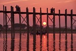 Sunset at U Bien pedestrian bridge on Taungthaman Lake at Amarapura, near Mandalay.