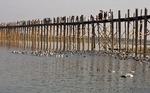 U Bien pedestrian bridge made of teak wood, on duck-filled Taungthaman Lake at Amarapura, near Mandalay.
