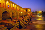Khaju Bridge on Zayande (Zaindeh) River in Isfahan (Esfahan) with people in evening