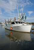 Shrimp Boat at dock of Billy's Seafood on Alabama Gulf Coast.