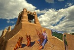 Mural on adobe building in Taos, New Mexico.