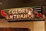 Racial segregation sign for Colored Entrance at History Museum of Mobile.