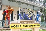 Mardi Gras figures at entrance of Mobile Carnival Museum.