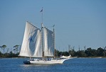 Biloxi Oyster Schooner sailing along Deer Island in Mississippi Sound of Gulf Coast.