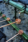 Shinto Shrine in Kyoto, Hishaku bamboo ladles on water fountain for drinking and purification ritual