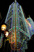 Las Fallas Festival electric light tower display fills street.