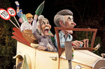 Las Fallas Festival satirical effigy falla of family in car.