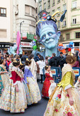 Las Fallas Festival falleras in parade passing satirical effigy falla.