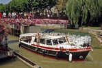 Private pleasure boat leaving lock of Canal de la Robine, Narbonne, France.