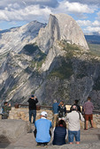 Yosemite National Park with tourists at Glacier Point overlook viewing Half Dome.