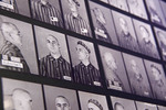 Auschwitz-Birkenau Memorial Museum display of holocaust victims photographs