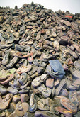 Auschwitz-Birkenau Memorial Museum exhibit of shoes of holocaust victims.