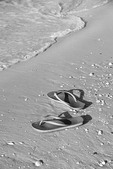 Flip flops on beach in Florida.