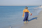 Woman wading in surf on Siesta Key Beach at Sarasota, Florida.