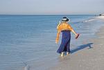 Woman wading in surf on Siesta Key Beach at Sarasota, Florida.