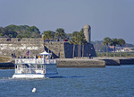 Scenic cruise boat Victory III on Matanzas Bay approaching Castillo de San Marcos, Spanish built fortress in St. Augustine, Florida.