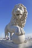 Stone lion guarding entrance to Bridge of Lions on Matanzas Bay in St. Augustine, Florida.