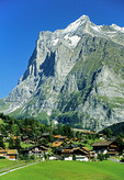 Wetterhorn peak towering over Gindelwald in Bernese Oberland Alps in summer.