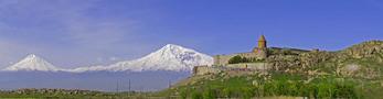 Khor Virap Armenian Apostolic Church monastery in Armenia with peaks of Mount Ararat in distant Turkey.