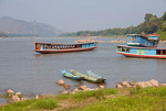 Boats on Mekong River near Luang Prabang, Laos.