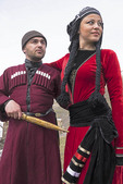 Georgian couple in traditional dress in Caucasus mountain village of Ushguli in Upper Svaneti, highest village in Europe.
