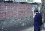 Dazibao (big character posters) on Democracy Wall in Beijing with worker taking notes in 1978.
