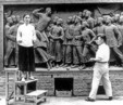 Sculptor with model making stone relief for Beijing's Tiananmen Square commemorating the May 4th Movement in China.