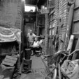 Courtyard of a Beijing hutong residence with coal stove in 1990s.