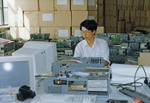 Chinese-made IBM clone computers being assembled in Beijing for export to Russia in 1990.