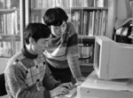 Early Chinese-made Lenovo computer being used by a father and son in Beijing in 1986.