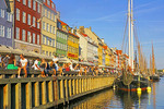 Tourists on Nyhavn waterfront in Copenhagen, Denmark.