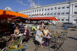 Outdoor cafe in Helsinki's Market Square with Embassy of Sweden in background.