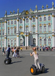 Tourists on Segways at The State Hermitage Museum's Winter Palace in St. Petersburg, Russia.
