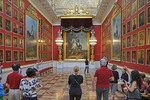 Tourists in gallery dedicated to Victory over Napoleon in State Hermitage Museum in St. Petersburg, Russia.