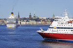 Cruise ships in Stockholm harbor with Gamla Stan (Old Town) in background.