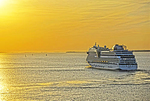 AIDA mar cruise ship leaving port of St. Petersburg, Russia, at sunset. (NOTE: This is PHOTO ART, a HDR Painting rendition)