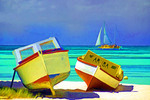Colorful boats on white sand beach in Aruba.