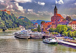 Germany: Danube River cruise ships at Passau with St Paul Church above