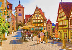 Rothenburg ob der Tauber's  Plonlein (Little Square) with Siebers Town Tower and town gate with clock on upper street and Kobolzeller Gate on lower street.