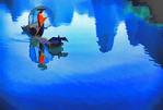 Young cormorant fisherman on bamboo raft on the Li River near Xingping