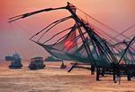 Cantilevered Chinese fishing nets at sunset at Cochin (Kochi) on Malabar coast of Arabian Sea in Kerala