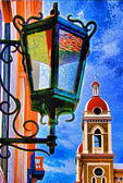 Nicaragua: Spanish colonial Granada architecture, the Cathedral bell tower and Hotel La Gran Francia lamp