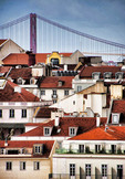 Lisbon rooftops with Ponte 25 de Abril suspension bridge